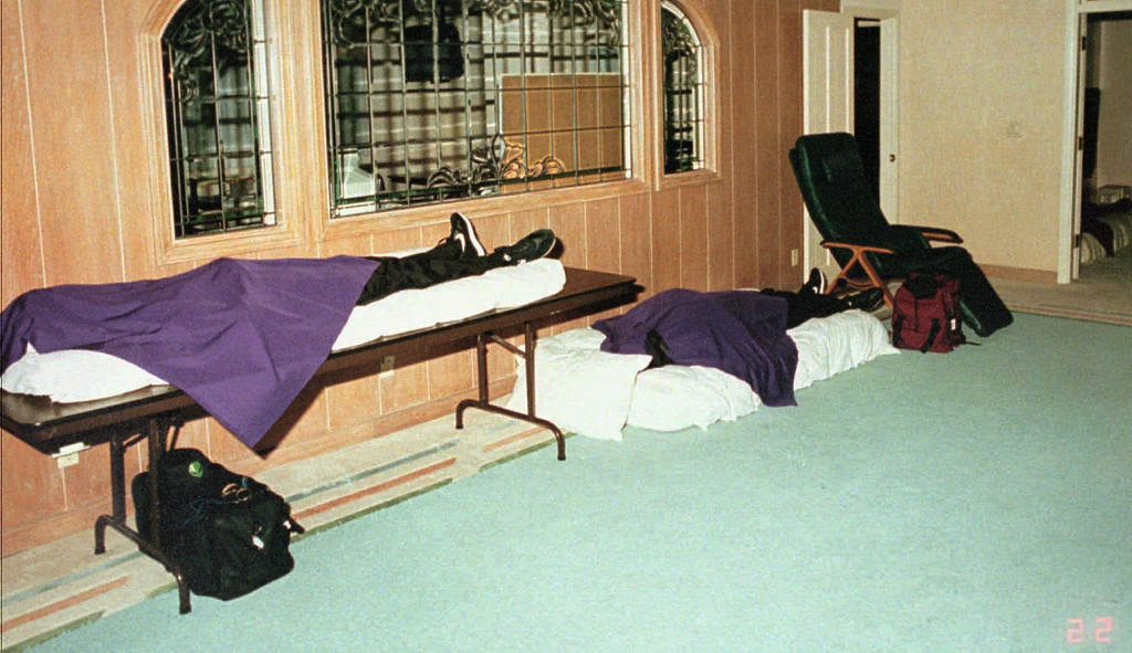 ". A photo released during a news conference Thursday, March 27, 1997 by the San Diego Sheriff\'s department showing the inside of the Rancho Sante Fe, Calif. estate where 39 bodies were found Wednesday. After reports of an object trailing the comet Halle-Bopp the group took it as a sign aliens had come for them and they had to abandon their ""vehicles\"" or bodies to be reunited with the aliens and saved from armageddon. (AP Photo/Nick Ut)"