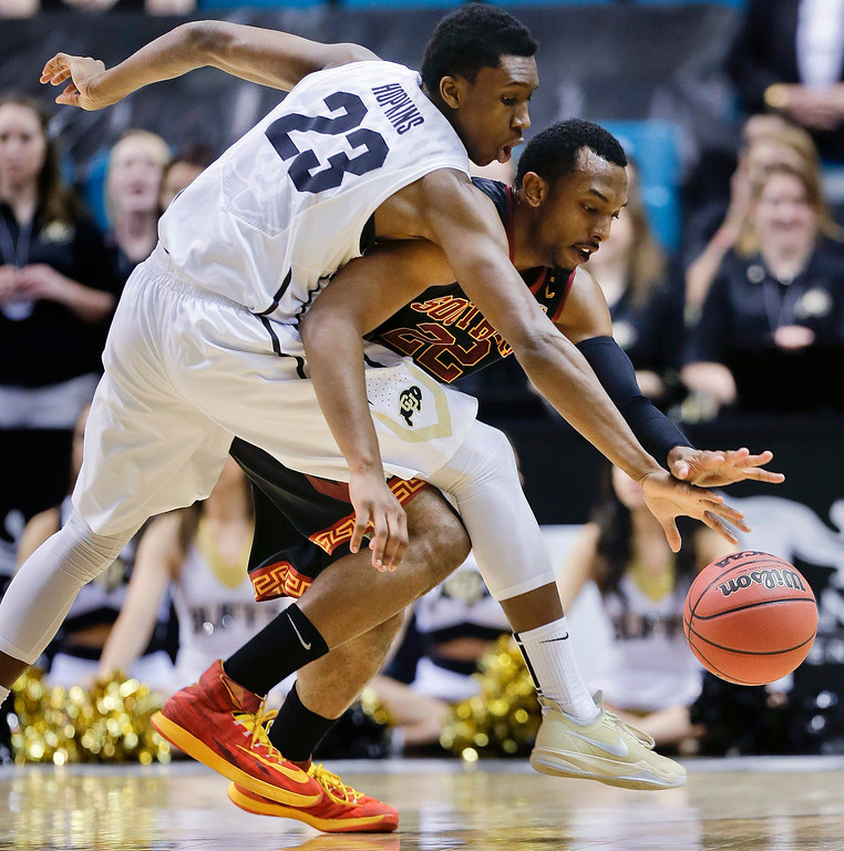 . Colorado\'s John Hopkins (23) reaches to strip Southern California\'s Byron Wesley of the ball in the first half of an NCAA college basketball game in the Pac-12 men\'s tournament, Wednesday, March 12, 2014, in Las Vegas. (AP Photo/Julie Jacobson)