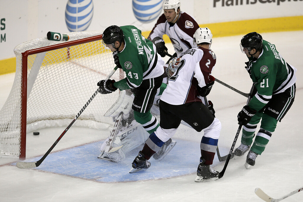 . Dallas Stars right wing Valeri Nichushkin (43), of Russia, scores a goal against Colorado Avalanche goalie Semyon Varlamov, left, also of Russia, as Avalanche\'s Nick Holden (2), Matt Hunwick (22) and the Stars\' Antoine Roussel watch in the third period of a preseason NHL hockey game on Thursday, Sept. 26, 2013, in Dallas. The Stars won 5-1. (AP Photo/Tony Gutierrez)