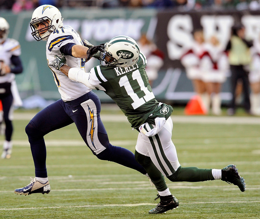 . San Diego Chargers strong safety Corey Lynch (41) stiff-arms New York Jets wide receiver Jeremy Kerley (11) during the second half of an NFL football game on Sunday, Dec. 23, 2012, in East Rutherford, N.J. (AP Photo/Bill Kostroun)