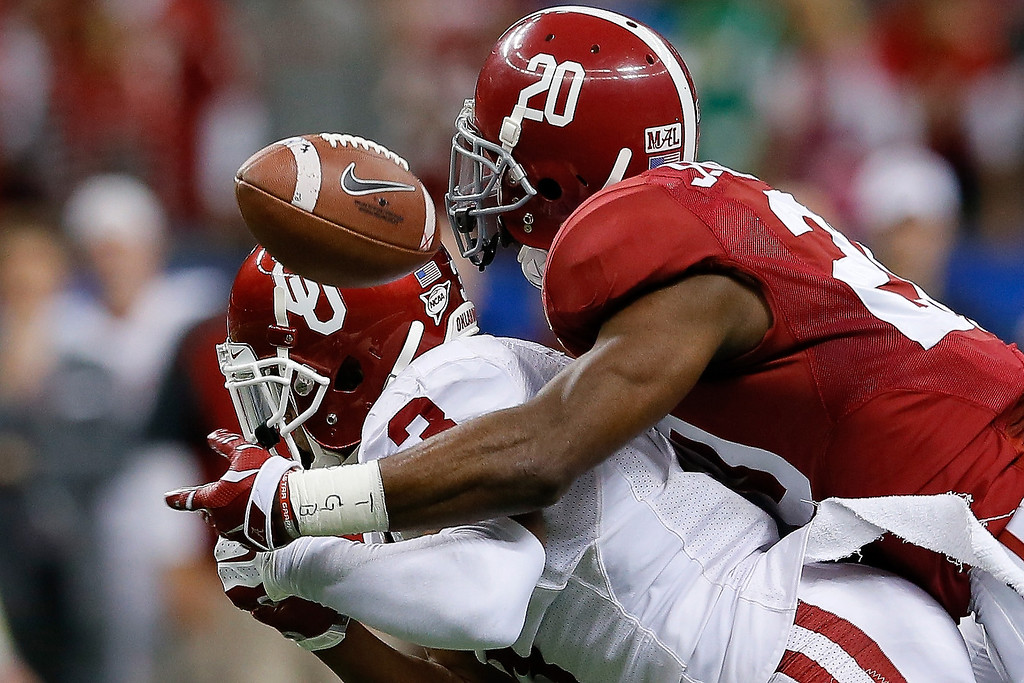 . NEW ORLEANS, LA - JANUARY 02:  Jarrick Williams #20 of the Alabama Crimson Tide breaks up a pass intended for Sterling Shepard #3 of the Oklahoma Sooners during the Allstate Sugar Bowl at the Mercedes-Benz Superdome on January 2, 2014 in New Orleans, Louisiana.  (Photo by Kevin C. Cox/Getty Images)