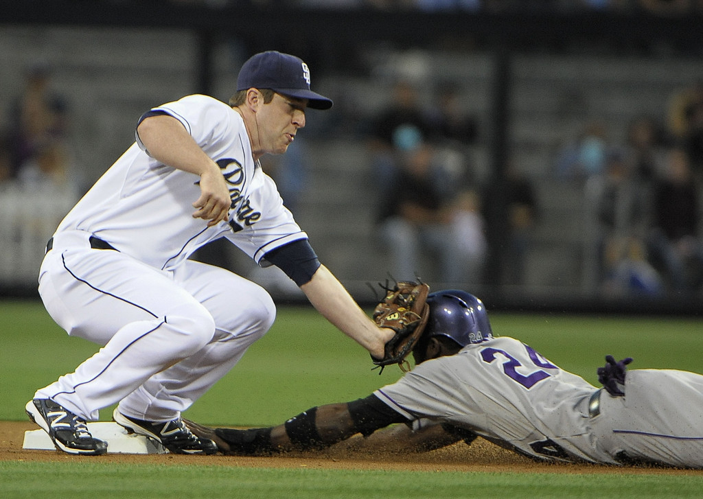 . SAN DIEGO, CA - APRIL 12:  Jedd Gyorko #9 of the San Diego Padres tags out Dexter Fowler #24 of the Colorado Rockies as he tries to steal second base in the first inning of a baseball game at Petco Park on April 12, 2013 in San Diego, California.  (Photo by Denis Poroy/Getty Images)