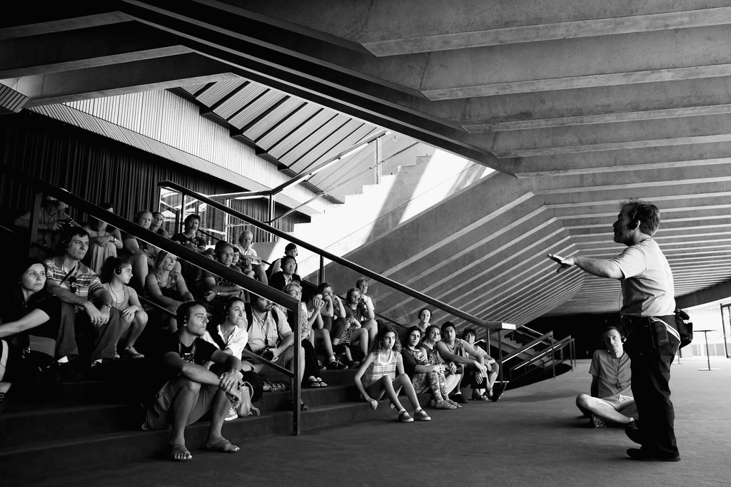 . A tour guide presents to tourists at the Sydney Opera House on September 26, 2013 in Sydney, Australia.   (Photo by Cameron Spencer/Getty Images)