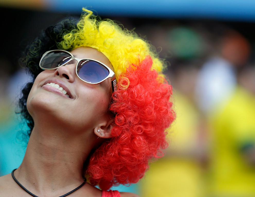 . A Belgium supporter wears a colored wig before the World Cup round of 16 soccer match between Belgium and the USA at the Arena Fonte Nova in Salvador, Brazil, Tuesday, July 1, 2014. (AP Photo/Marcio Jose Sanchez)