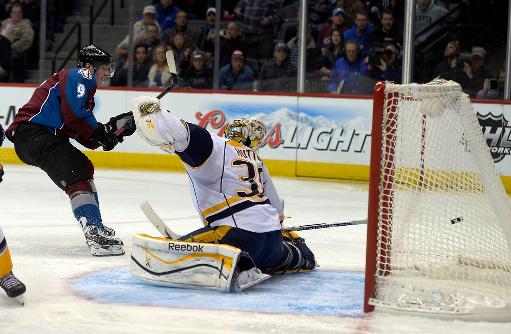 . Colorado Avalanche center Matt Duchene (9) takes a shot on goal and scores during the third period on Nashville Predators goalie Carter Hutton (30)  November 6, 2013 at Pepsi Center. Nashville Predators defeated the Colorado Avalanche 6-4. (Photo by John Leyba/The Denver Post)