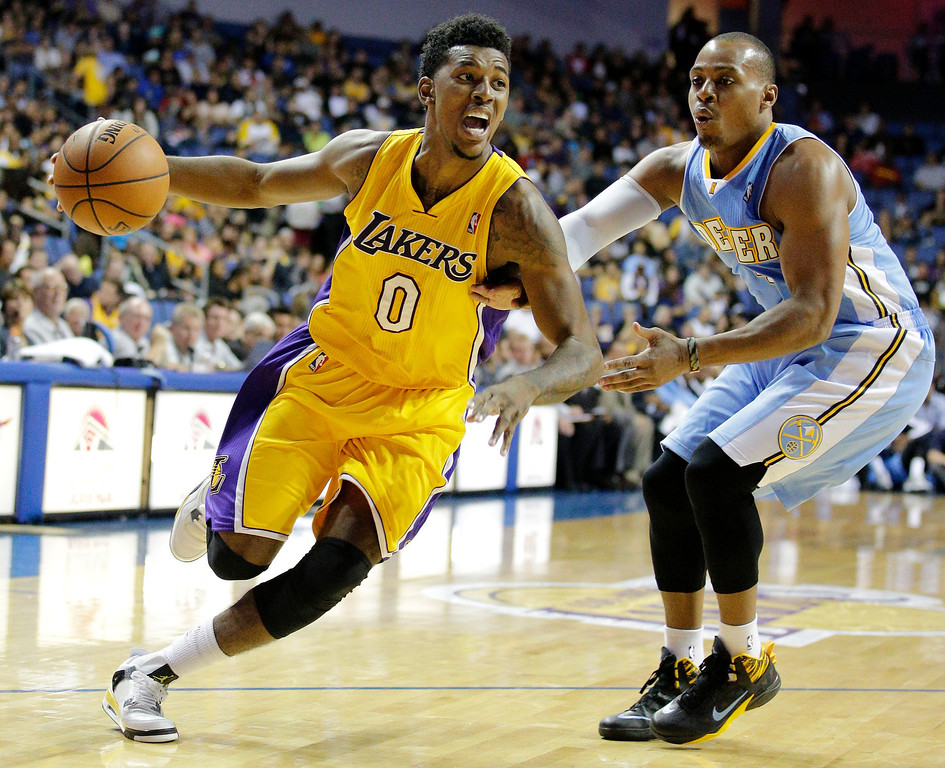 . Los Angeles Lakers\' Nick Young, left, drives past Denver Nuggets\' Randy Foye in the first half of an NBA preseason basketball game Tuesday, Oct. 8, 2013, in Ontario, Calif. (AP Photo/Jae C. Hong)