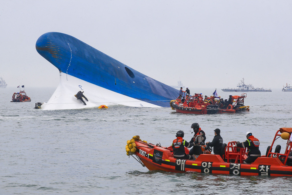 . In this handout provided by Donga Daily, The Republic of Korea Coast Guard work at the site of ferry sinking accident off the coast of Jindo Island  on April 16, 2014 in Jindo-gun, South Korea. Four people are confirmed dead and almost 300 are reported missing. The ferry identified as the Sewol is reported to have been carrying around 470 passengers, including students and teachers, as it travelled to Jeju island. (Photo by Park Young-Chul-Donga Daily via Getty Images)