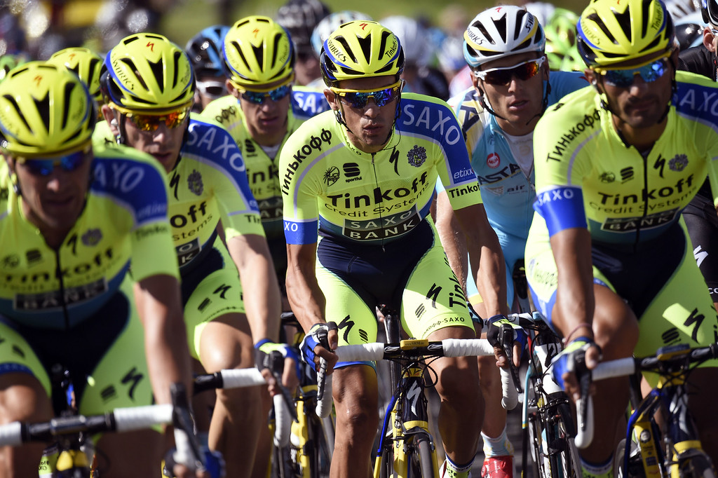 . Spain\'s Alberto Contador (C) rides with his teammates of the Russia\'s Tinkoff-Saxo cycling team during the 190.5 km first stage of the 101st edition of the Tour de France cycling race on July 5, 2014 between Leeds and Harrogate, northern England.  The 2014 Tour de France gets underway on July 5 in the streets of Leeds and ends on July 27 down the Champs-Elysees in Paris. ERIC FEFERBERG/AFP/Getty Images
