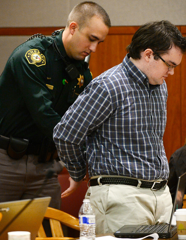 . Austin Sigg, right, is handcuffed by a sheriff\'s deputy during a recess in district court in Golden, Colo., on Monday, Nov. 18, 2013, during his sentencing hearing. Sigg pleaded guilty last month to kidnapping and killing Jessica Ridgeway in Westminster in October 2012. (Photo by RJ Sangosti/The Denver Post)