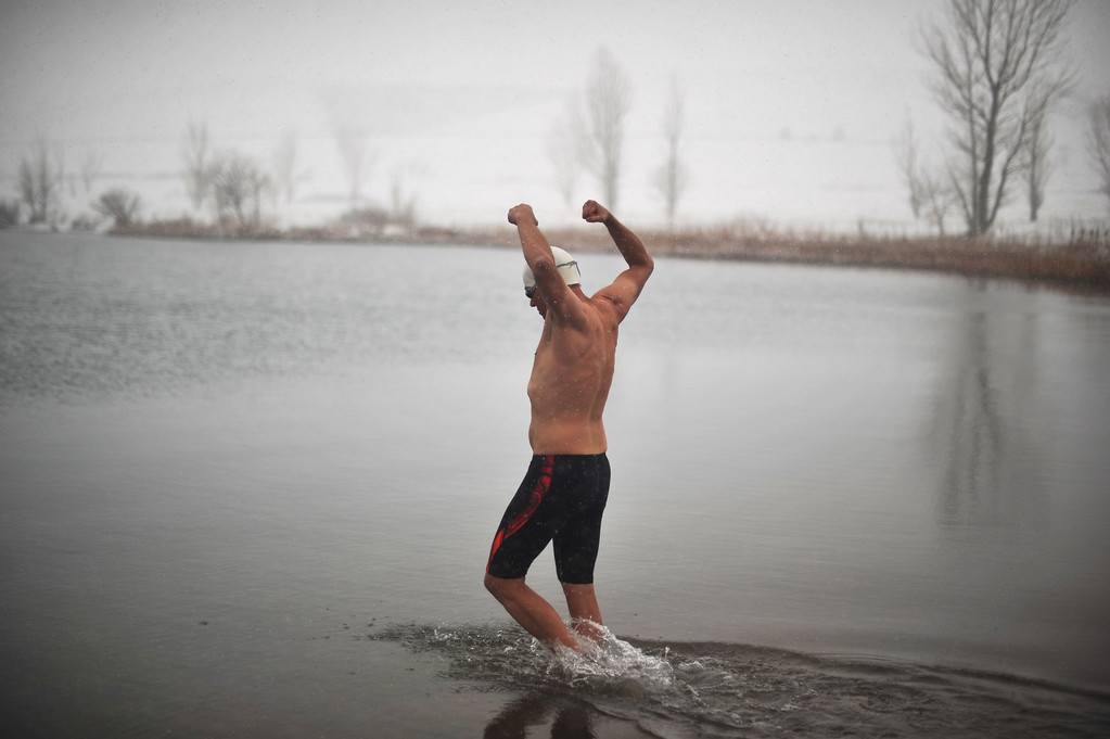 . LITTLETON, CO. - MAY 01 : Jeffrey Hulett of Golden walks into the water. Four swimmers from Colorado Masters Swimming Association are swimming at the Gravel Pond in Chatfield State Park for the opening day of the open water swimming season. Littleton, Colorado. May 1, 2013. (Photo By Hyoung Chang/The Denver Post)