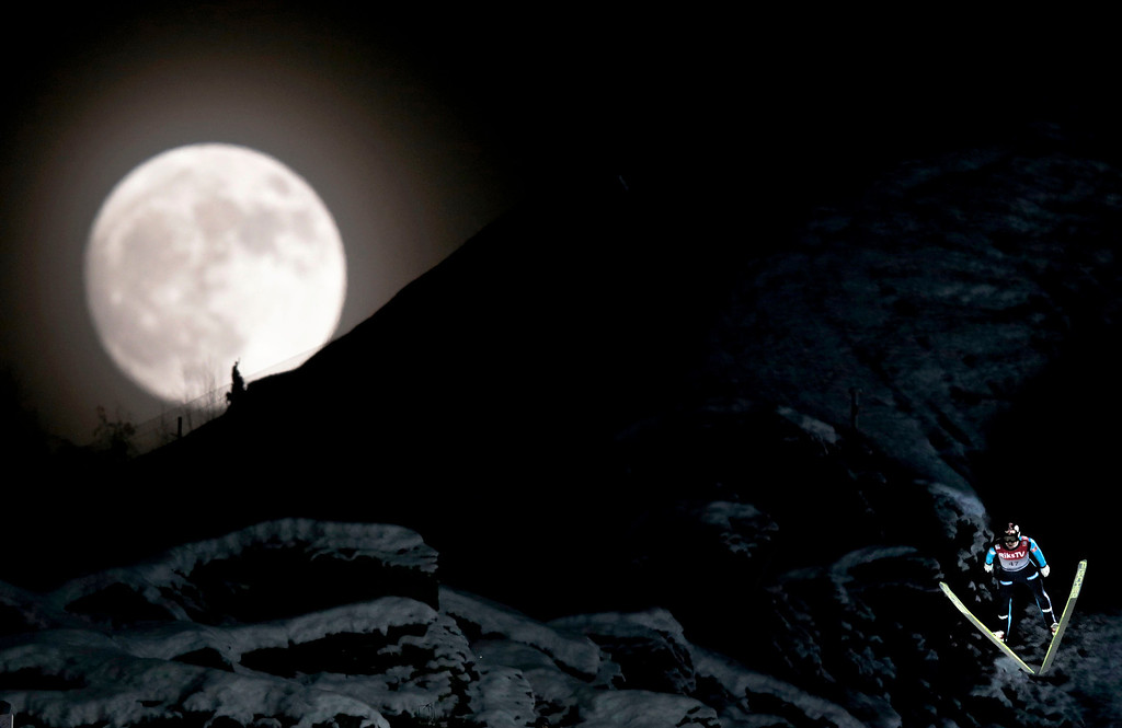. Norway\'s Anders Bardal jumps during the official training session of the FIS Ski Flying World Cup in Vikersund, Norway on January 25, 2013,  while a full moon rises over the mountain.  DANIEL SANNUM LAUTEN/AFP/Getty Images