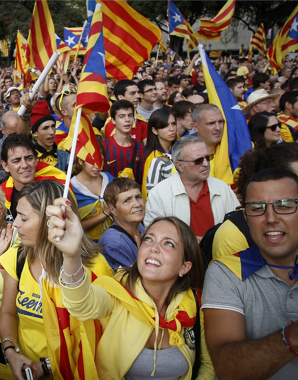 . People wave Catalonian national flags in Barcelona, Spain Wednesday Sept. 11, 2013. Several hundred thousand people demanding an independent Catalonia have joined hands in an attempt to form a 400-kilometer (250-mile) human chain across the northeastern region of Spain. The demonstration Wednesday aimed to illustrate local support for political efforts to break away from Spain. Organizers estimated about 400,000 people took part in the human chain. Catalonia claims a deep cultural difference based on its language, which is spoken side-by-side with Spanish in the wealthy region. (AP Photo/Paco Serinelli)