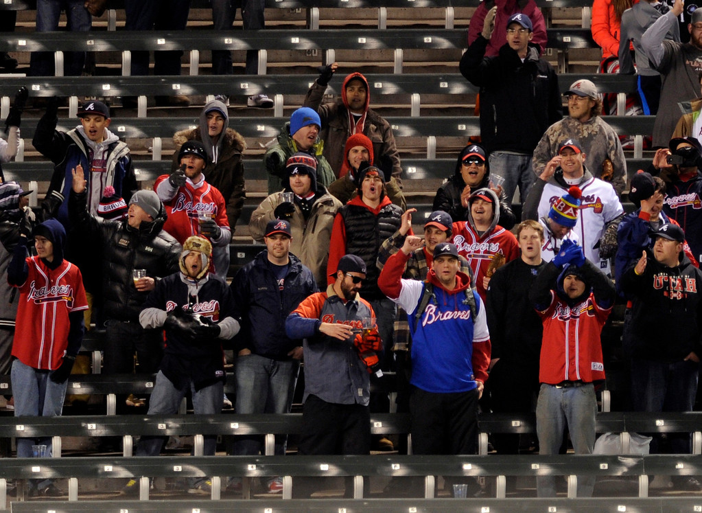 . DENVER, CO. - APRIL 23:  Atlanta fans taunted the locals with their Tomahawk Chop in the ninth inning. The Atlanta Braves defeated the Colorado Rockies 10-2 in the second game of a doubleheader Tuesday night April 23, 2013 at Coors Field. Photo By Karl Gehring/The Denver Post