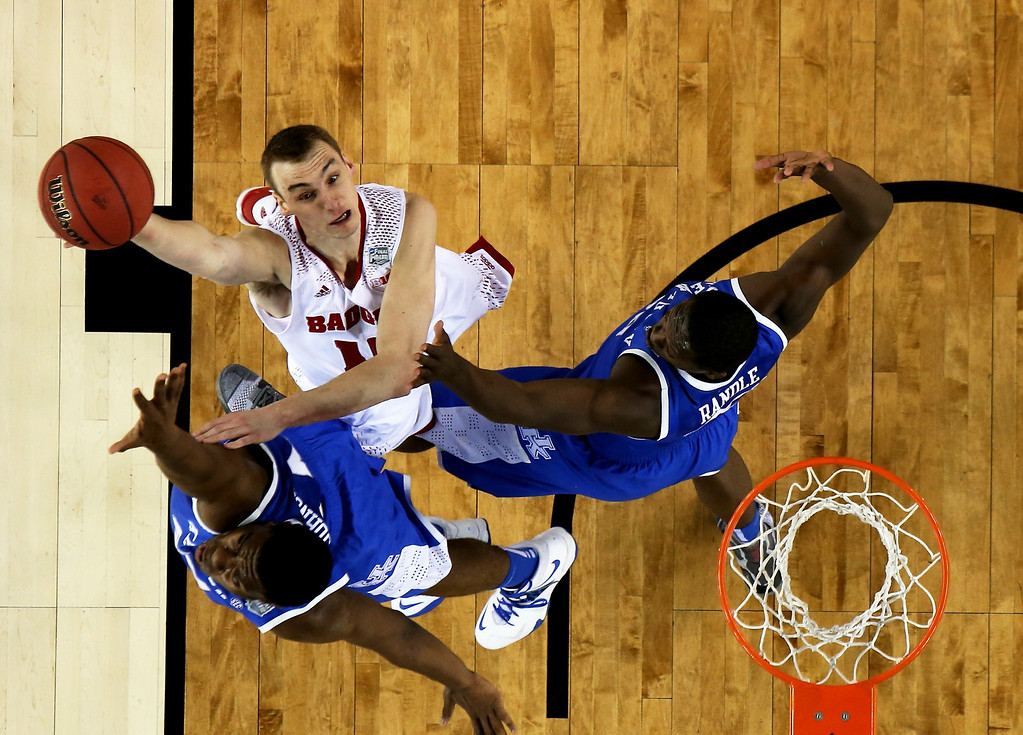 . ARLINGTON, TX - APRIL 05: Sam Dekker #15 of the Wisconsin Badgers goes up for a shot as Julius Randle #30 of the Kentucky Wildcats defends during the NCAA Men\'s Final Four Semifinal at AT&T Stadium on April 5, 2014 in Arlington, Texas.  (Photo by Jamie Squire/Getty Images)