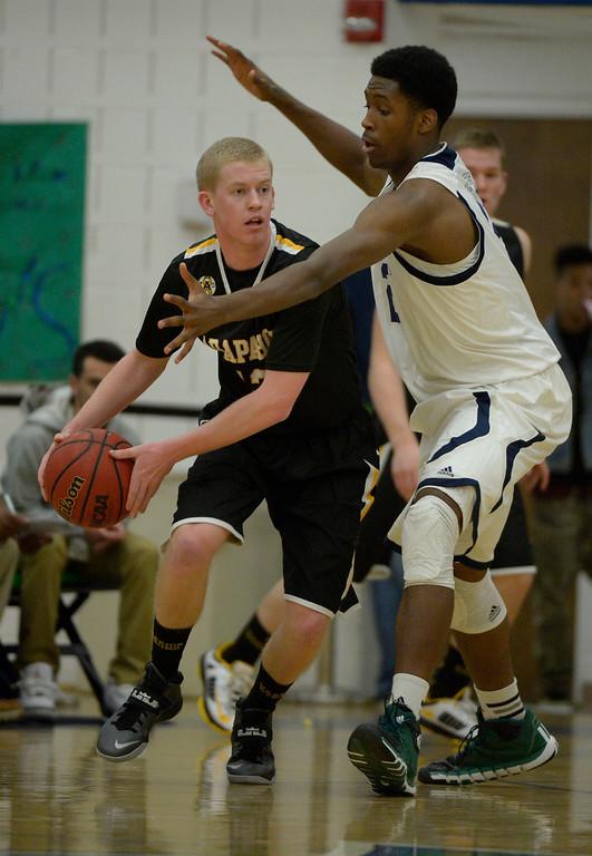 . AURORA, CO - FEBRUARY 12: Overland De\'Ron Davis (20) plays tough defense on Arapahoe Brendan Till (13) during their 5A basketball game February 12, 2014 in Aurora. (Photo by John Leyba/The Denver Post)