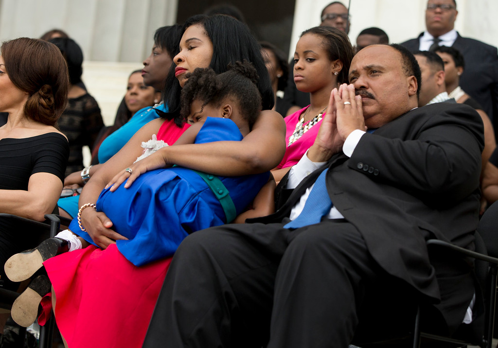""". Martin Luther King III, right, his wife Arndrea Waters, left, and their daughter Yolanda Renee King, listen as President Barack Obama speaks a ceremony commemorating the 50th anniversary of the March on Washington, Wednesday, Aug. 28, 2013, at the Lincoln Memorial in Washington. The president was set to lead civil rights pioneers Wednesday in a ceremony for the 50th anniversary of the March on Washington, where Dr. Martin Luther King\'s \""""I Have a Dream\"""" speech roused the 250,000 people who rallied there decades ago for racial equality. (AP Photo/Evan Vucci)"""