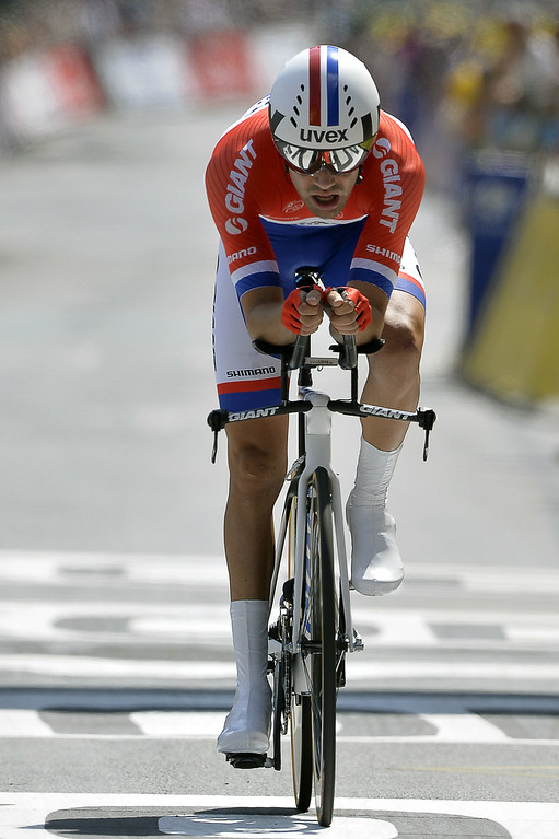 . Netherlands\' Tom Dumoulin crosses the finish line at the end of the twentieth stage, a 54 km individual time trial, as part of the 101st edition of the Tour de France cycling race on July 26, 2014 between Bergerac and Perigueux, western France.  AFP PHOTO / ERIC FEFERBERG/AFP/Getty Images
