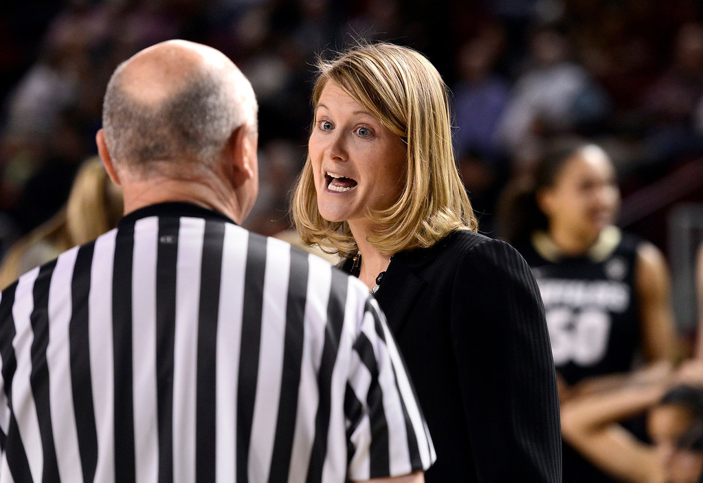 . University of Colorado head coach Linda Lappe has words with the referee during a games against the University of Denver on Tuesday, Dec. 11, at the Magnus Arena on the DU campus in Denver.   (Jeremy Papasso/Daily Camera)