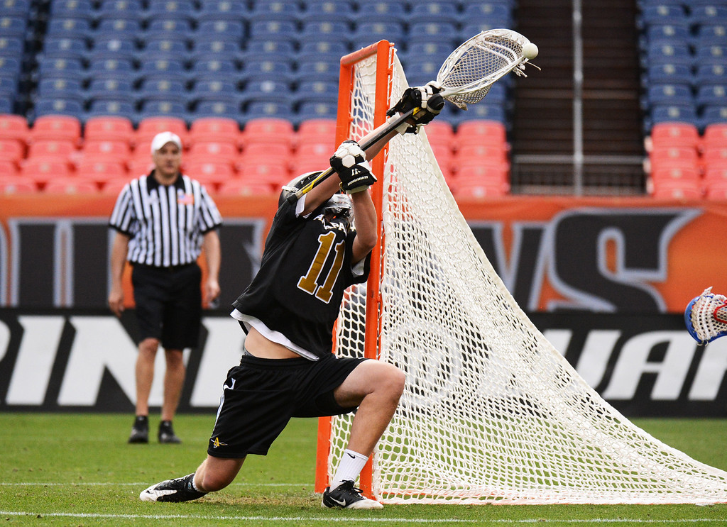 . DENVER, CO. - MAY 18 : Goalie Ryan Smith of Arapahoe High School (11) saves the goal from the shot of Julian Schwab of Cherry Creek High School (6) during 5A Boy\'s Lacrosse Championship game at Sports Authority Field at Mile High Stadium. Denver, Colorado. May 18, 2013. Arapahoe won 10-7. (Photo By Hyoung Chang/The Denver Post)