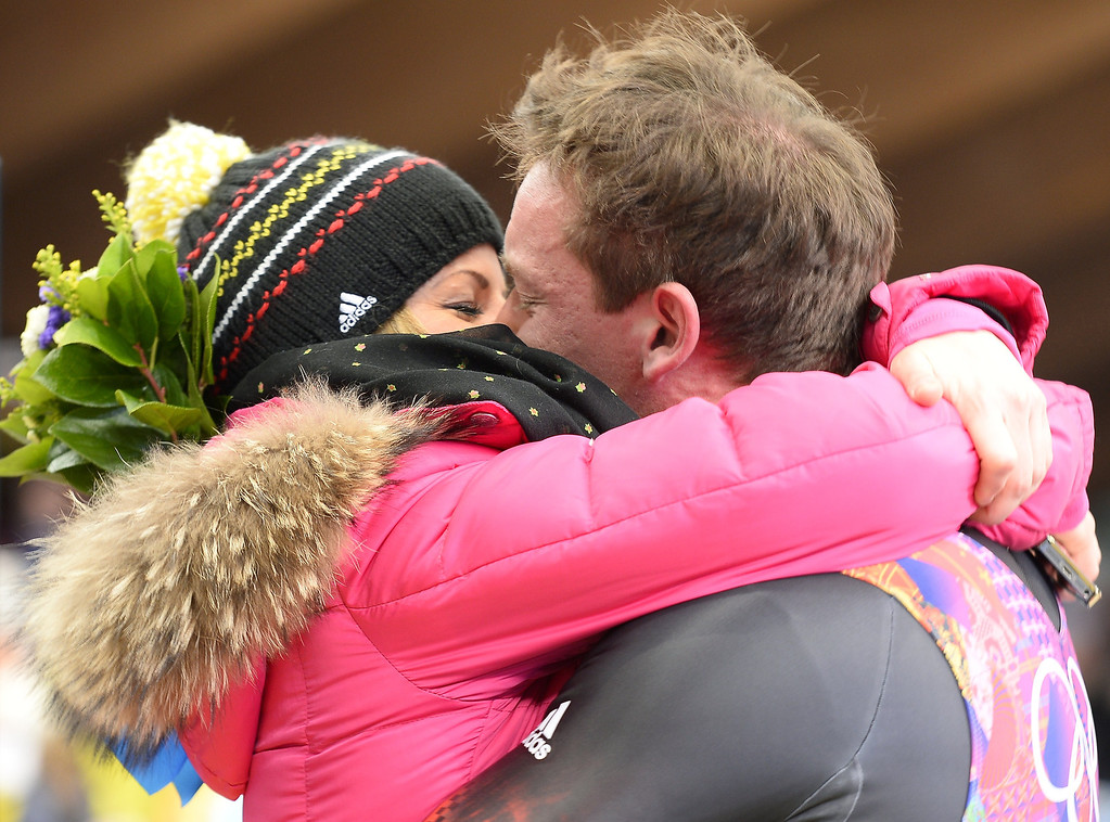 . Gold Medallist, Germany\'s Felix Loch kisses his girlfriend, Lisa Ressle, after the Men\'s Luge final at the Sanki Sliding Center during the Sochi Winter Olympics on February 9, 2014.         LIONEL BONAVENTURE/AFP/Getty Images