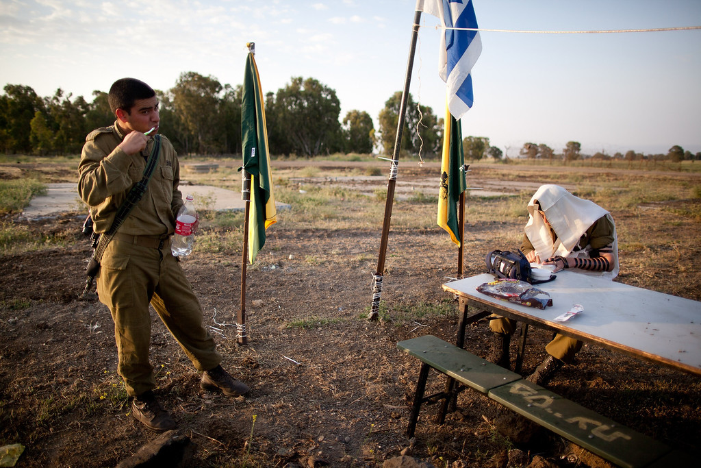 . GOLAN HEIGHTS - MAY 07:  An Israeli soldier of the Golani brigade prays while his unit takes part in a military exercise May 7, 2013 near the border with Syria, in the Israeli-annexed Golan Heights. Syria has accused Israel of launching a series of airstrikes on targets near the Lebanon/Syria border, including an arms shipment and the Jamraya research centre, that was thought to produce chemical weapons.  (Photo by Uriel Sinai/Getty Images)