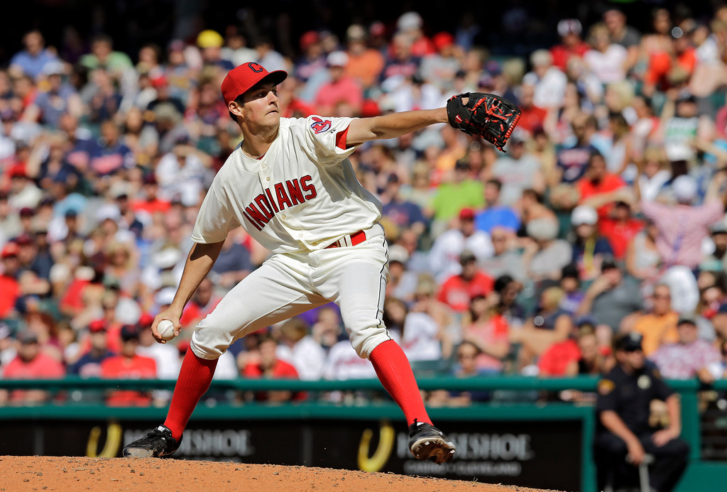 . Cleveland Indians starting pitcher Trevor Bauer delivers against the Colorado Rockies in the fifth inning of a baseball game Saturday, May 31, 2014, in Cleveland. (AP Photo/Mark Duncan)