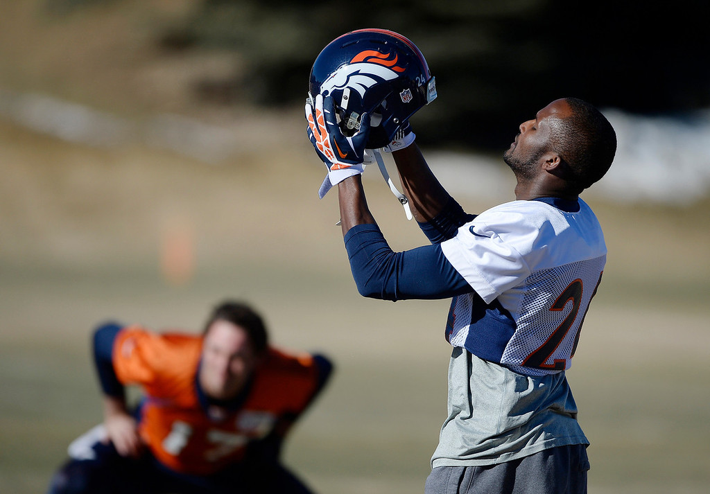 . Denver Broncos cornerback Champ Bailey puts his helmet on at the start of practice at Dove Valley Saturday morning, January 25, 2014. (Photo By Andy Cross / The Denver Post)