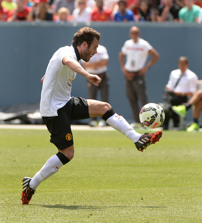 . Manchester United midfielder Juan Mata controlled a pass with his left foot on the way to his goal in the first half. Manchester United took on AS Roma in an exhibition soccer game at Sports Authority Field in Denver Saturday afternoon, July 27, 2014. Photo by Karl Gehring/The Denver Post