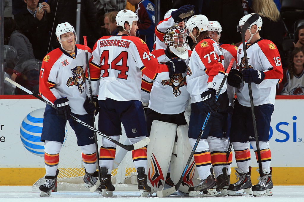 . DENVER, CO - NOVEMBER 16:  The Florida Panthers celebrate their 4-1 victory over the Colorado Avalanche at Pepsi Center on November 16, 2013 in Denver, Colorado. Goalie Tim Thomas #34 of the Florida Panthers earned the win with 32 saves and Tom Gilbert #77 of the Florida Panthers had three assists and was named the number one star. (Photo by Doug Pensinger/Getty Images)