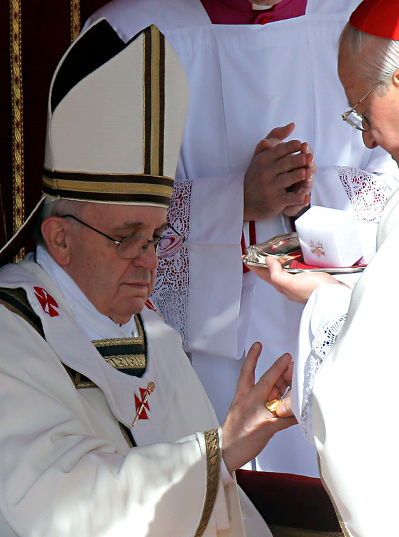 . Pope Francis is bestowed the Fisherman\'s Ring by Cardinal Angelo Sodano during his inaugural Mass, in St. Peter\'s Square at the Vatican, Tuesday, March 19, 2013. (AP Photo/Dmitry Lovetsky)