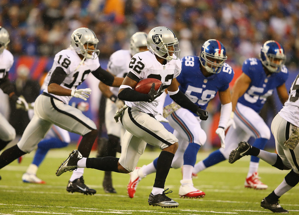 . Taiwan Jones #22 of the Oakland Raiders runs against the New York Giants during their game at MetLife Stadium on November 10, 2013 in East Rutherford, New Jersey.  (Photo by Al Bello/Getty Images)