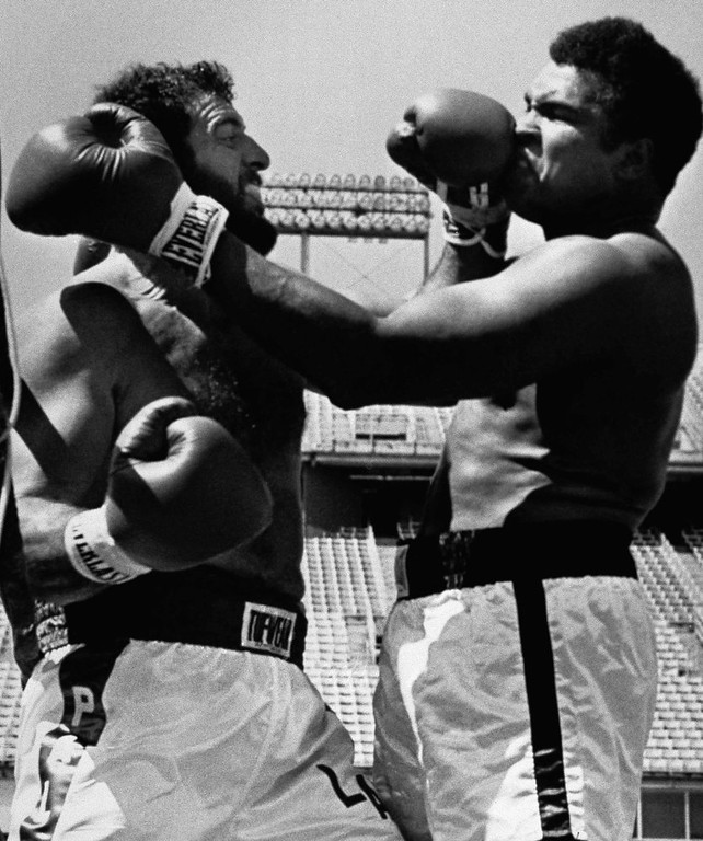 . Lyle Alzado, left, defensive end for the Denver Broncos, gets in a left as he and Muhammad Ali battle on the ropes during eight-round exhibition fight on Saturday, July 16, 1979 at Denver\'s Mile High Stadium. (AP Photo/EA)