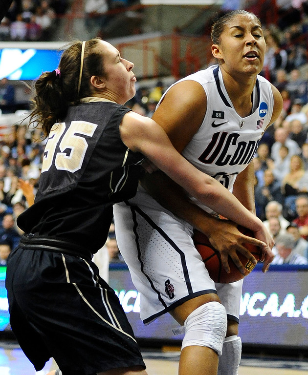 . Connecticut\'s Kaleena Mosqueda-Lewis, right, is pressured by Idaho\'s Connie Ballestero, left, in the first half of a first-round game in the women\'s NCAA college basketball tournament in Storrs, Conn., Saturday, March 23, 2013. (AP Photo/Jessica Hill)