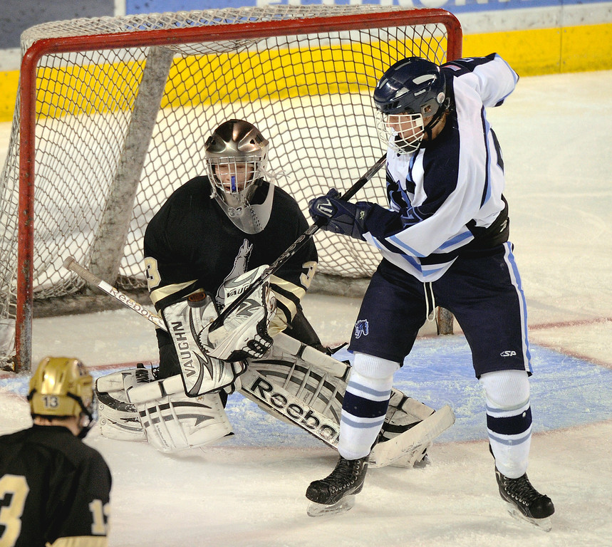 . DENVER, CO. - FEBRUARY 28: Mustangs forward Greg Dyba, right, tried to get a deflection on a shot towards Coyotes goalie Ian Oden in the third period. Ralston Valley High School beat Monarch 5-1 Friday night, March 1, 2013 to win the Colorado hockey championship at Magness Arena in Denver. (Photo By Karl Gehring/The Denver Post)