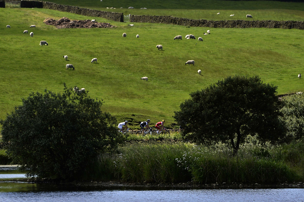 . France\'s Nicolas Edet (R), Germany\'s Jens Voigt (C), and France\'s Benoit Jarrier (L) ride in the breakaway during the 190.5 km first stage of the 101st edition of the Tour de France cycling race on July 5, 2014 between Leeds and Harrogate, northern England.  The 2014 Tour de France gets underway on July 5 in the streets of Leeds and ends on July 27 down the Champs-Elysees in Paris. JEFF PACHOUD/AFP/Getty Images