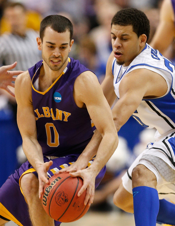 . Jacob Iati #0 of the Albany Great Danes moves the ball against Seth Curry #30 of the Duke Blue Devils during the second round of the 2013 NCAA Men\'s Basketball Tournament on March 22, 2013 at Wells Fargo Center in Philadelphia, Pennsylvania.  (Photo by Rob Carr/Getty Images)