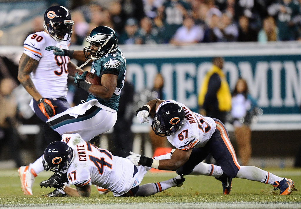 . Bryce Brown #34 of the Philadelphia Eagles is tackled by Chris Conte #47 of the Chicago Bears during the first half at Lincoln Financial Field on December 22, 2013 in Philadelphia, Pennsylvania.  (Photo by Maddie Meyer/Getty Images)