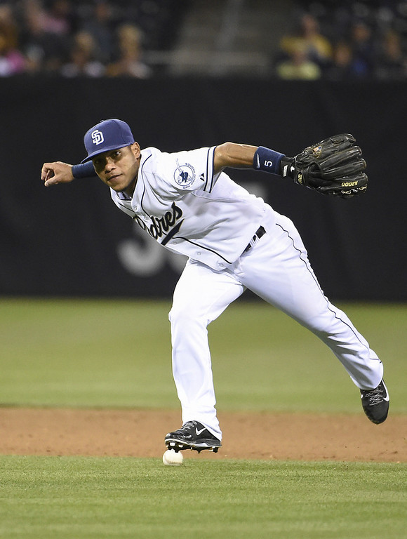 . SAN DIEGO, CA - APRIL 15:  Alexi Amarista of the San Diego Padres can\'t field a single hit by Wilin Rosario of the Colorado Rockies during the fifth inning of a baseball game at Petco Park April 15, 2014 in San Diego, California. All uniformed team members are wearing jersey number 42 in honor of Jackie Robinson Day. (Photo by Denis Poroy/Getty Images)