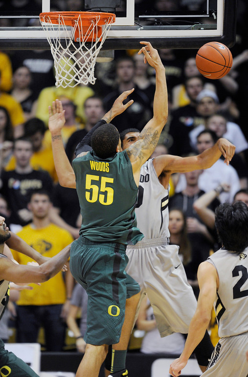 . BOULDER, CO. - MARCH 7: Colorado center Josh Scott (40) rejected a shot from Oregon center Tony Woods (55) in the second half. The University of Colorado men\'s basketball team defeated Oregon 76-53 Thursday night, March 7, 2013 at the CU Events Center in Boulder. (Photo By Karl Gehring/The Denver Post)