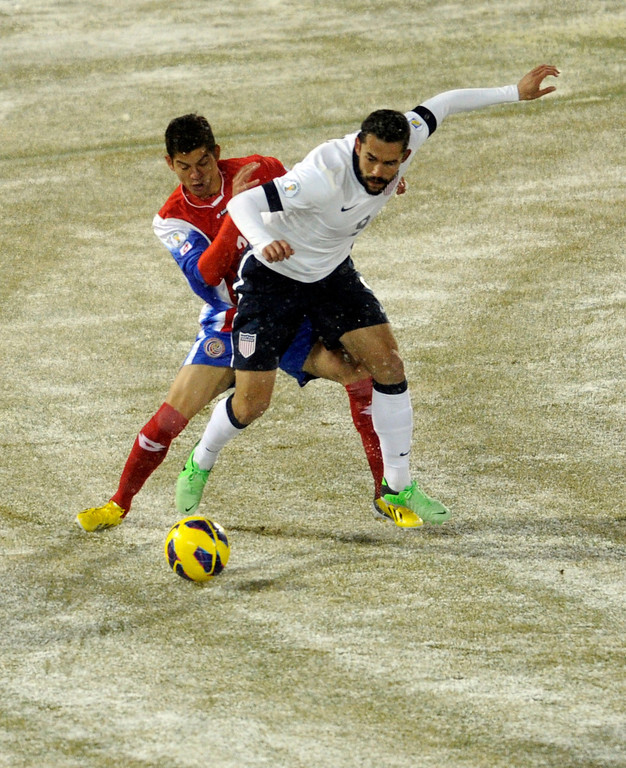 . COMMERCE CITY, CO. - MARCH 22: United States forward Herculez Gomez (9) went for the ball with Costa Rica defender Michael Umana (4) in the first half. The U.S. Men\'s National Soccer Team hosted Costa Rica Friday night, March 22, 2013 in a FIFA World Cup qualifier at Dick\'s Sporting Goods Park in Commerce City.  (Photo By Karl Gehring/The Denver Post)