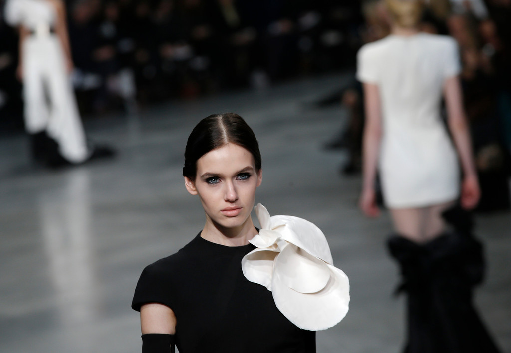 . A model presents a creation by French fashion designer Stephane Rolland  for his Spring Summer 2013 Haute Couture fashion collection, presented in Paris, Tuesday, Jan.22, 2013. (AP Photo/Christophe Ena)