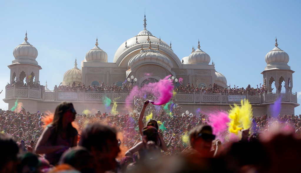 . Participants dance and throw colored chalk during the Holi Festival of Colors at the Sri Sri Radha Krishna Temple in Spanish Fork, Utah, March 30, 2013. According to organizers 50,000 people were expected pack the temple grounds to celebrate Holi, the passing of winter to spring, and throw colorful powder throughout the day. REUTERS/Jim Urquhart