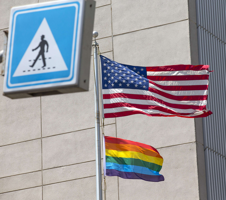 . A gay pride flag is raised next to the US flag is at the US embassy in the vicinity of the annual gay pride parade in the Israeli coastal city of Tel Aviv on June 13, 2014. AFP PHOTO/JACK GUEZ/AFP/Getty Images