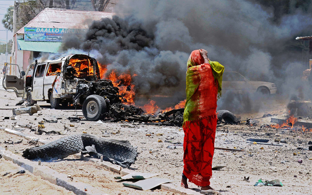 . A Somali woman reacts on March 18, 2013 near the site of a car bomb in central Mogadishu. At least eight people were killed by the car bomb in one of the bloodiest attacks in the war-ravaged capital in recent months, police said.     Mohamed Abdiwahab/AFP/Getty Images