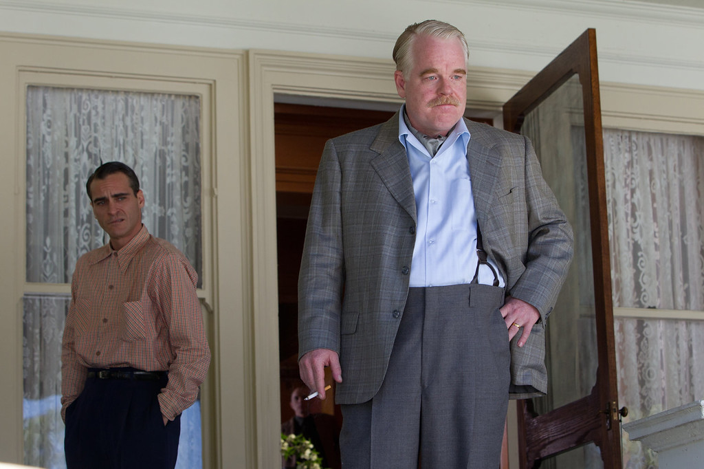 ". This file film image released by The Weinstein Company shows Joaquin Phoenix, left, and Philip Seymour Hoffman in a scene from ""The Master.\"" Police say Phillip Seymour Hoffman was found dead in his New York City apartment Sunday, Feb. 2, 2014. He was 46.  (AP Photo/The Weinstein Company, File)"