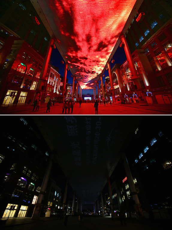 . BEIJING, CHINA - MARCH 23: This composite photograph shows a huge LED sky screen before and during the Earth Hour 2013 power switch off at the Central Business District on March 23, 2013 in Beijing, China. Earth Hour, launched in 2007 in Australia by the World Wide Fund for Nature (WWF), a global conservation group, calls on people, organizations and cities to turn off their non-essential lights for one hour starting at 8:30 p.m. local time.  (Photo by Feng Li/Getty Images)