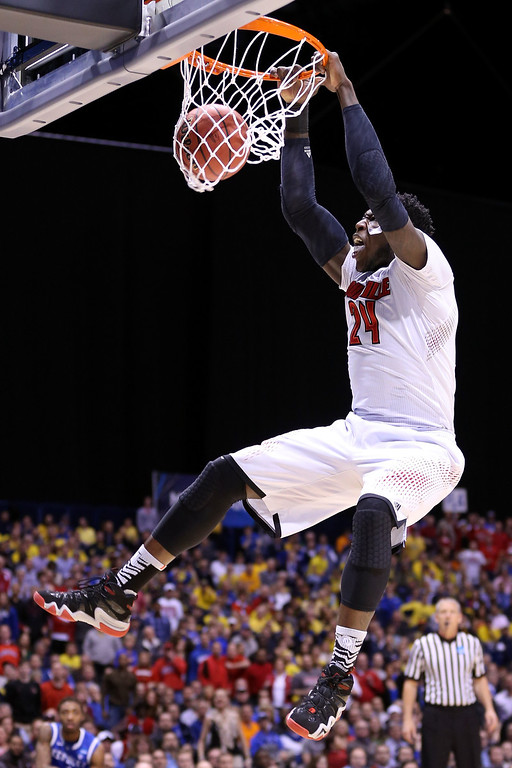 . Montrezl Harrell #24 of the Louisville Cardinals dunks the ball in the first half against the Kentucky Wildcats during the regional semifinal of the 2014 NCAA Men\'s Basketball Tournament at Lucas Oil Stadium on March 28, 2014 in Indianapolis, Indiana.  (Photo by Jonathan Daniel/Getty Images)