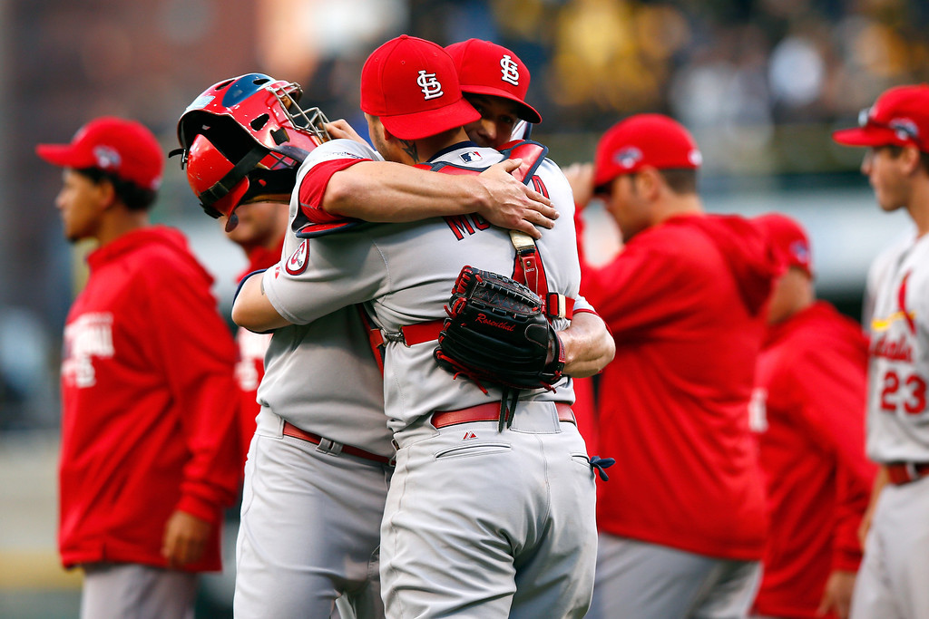 . Trevor Rosenthal #26 and Yadier Molina #4 of the St. Louis Cardinals celebrate defeating the Pittsburgh Pirates in Game Four of the National League Division Series at PNC Park on October 7, 2013 in Pittsburgh, Pennsylvania.  (Photo by Jared Wickerham/Getty Images)
