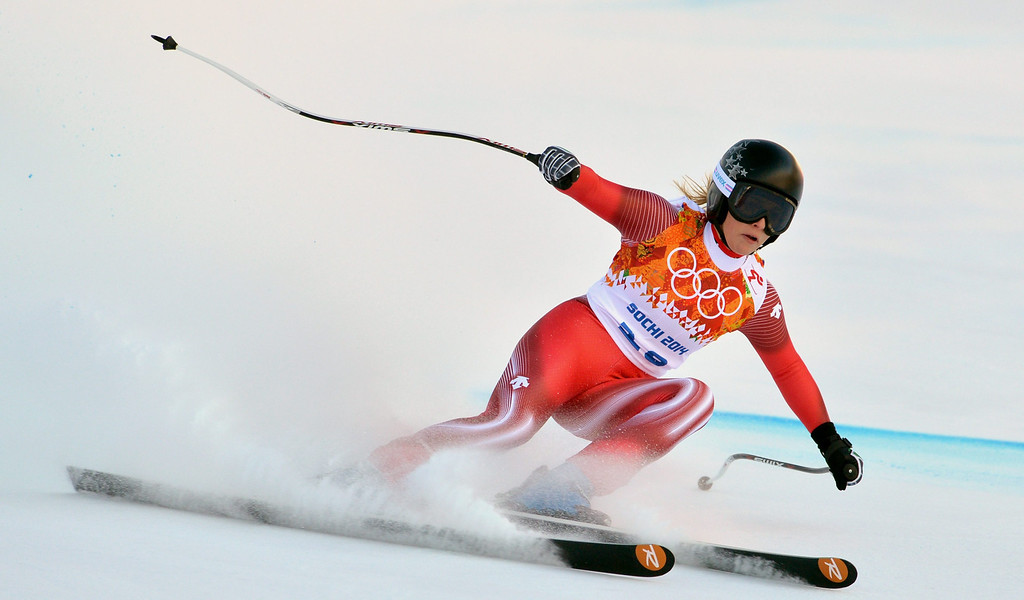 . epa04070972 Lara Gut of Switzerland in action during the Women\'s Downhill race at the Rosa Khutor Alpine Center during the Sochi 2014 Olympic Games, Krasnaya Polyana, Russia, 12 February 2014.  EPA/JUSTIN LANE