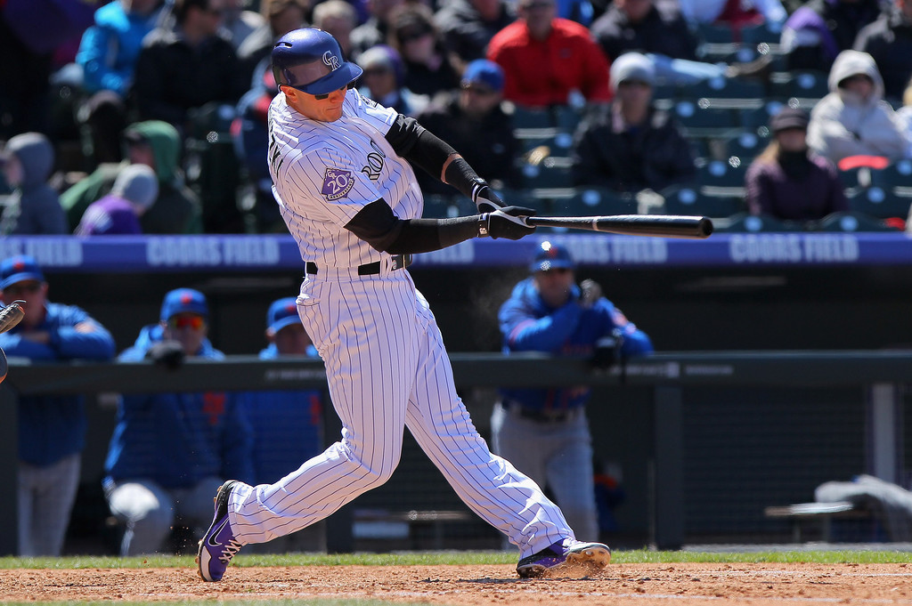 . Troy Tulowitzki #2 of the Colorado Rockies singles to score Carlos Gonzalez #5 of the Colorado Rockies to take a 3-2 lead over the New York Mets in the sixth inning at Coors Field on April 18, 2013 in Denver, Colorado.  (Photo by Doug Pensinger/Getty Images)